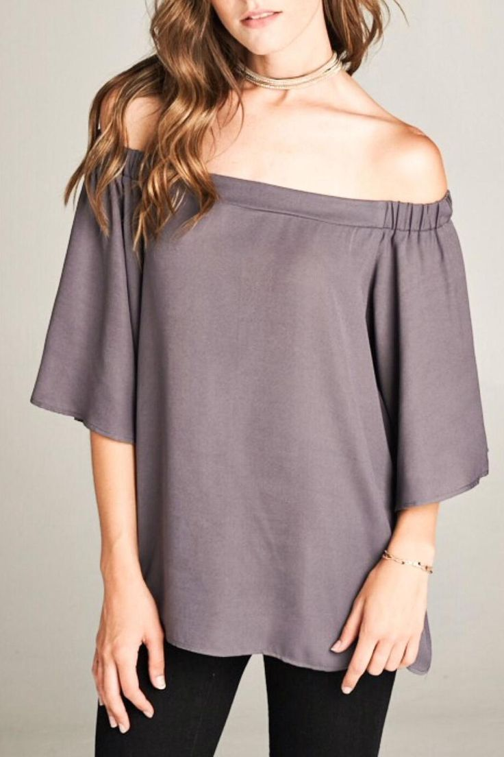 Off shoulder blouse with short bell sleeves. Loose fit and flowy.  Off Shoulder Blouse by LuLu's Boutique. Clothing - Tops Washington