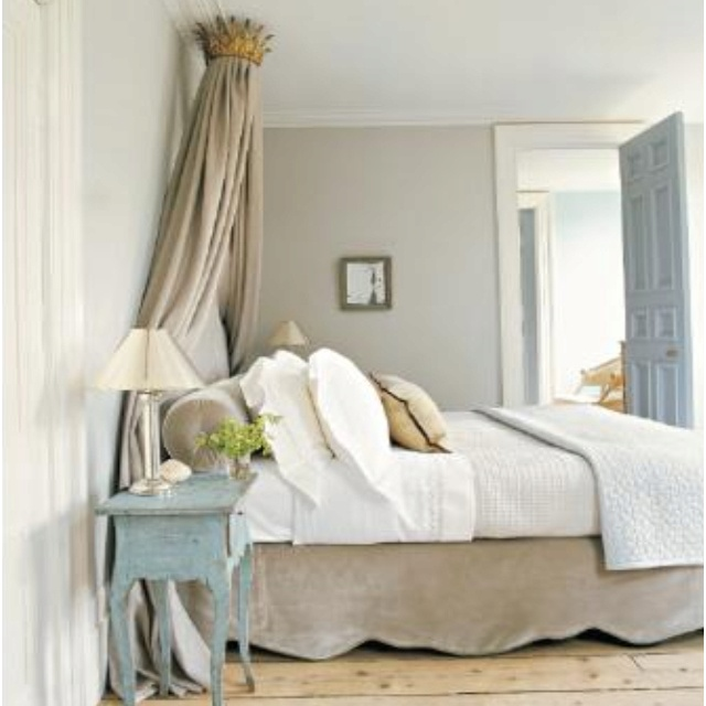 beautiful, peaceful bedroom. love the crown/curtain over the headboard.  (Martha Stewart Mag: May 2012)