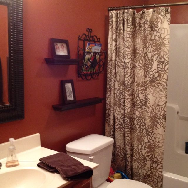 Burnt orange bathroom i wanted to do this color with my for Orange and grey bathroom accessories