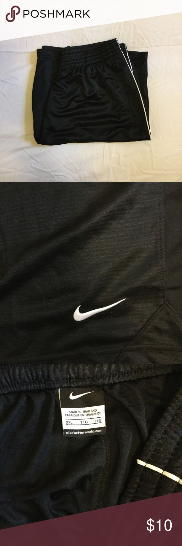 Men's Nike Basketball Shorts. All black Nike basketball shorts. Comfortable. Shiny material. Size XXL Nike Shorts Athletic