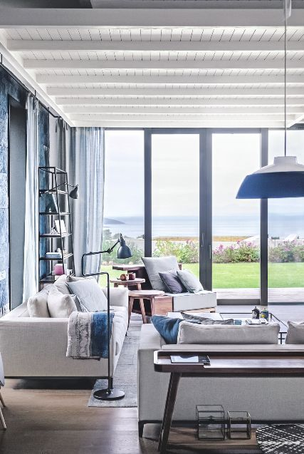 This Neutral Living Room Has Large Windows To Make The Most Gorgeous Coastal Views Blue Accents Chime With Landscape Image Livingetc