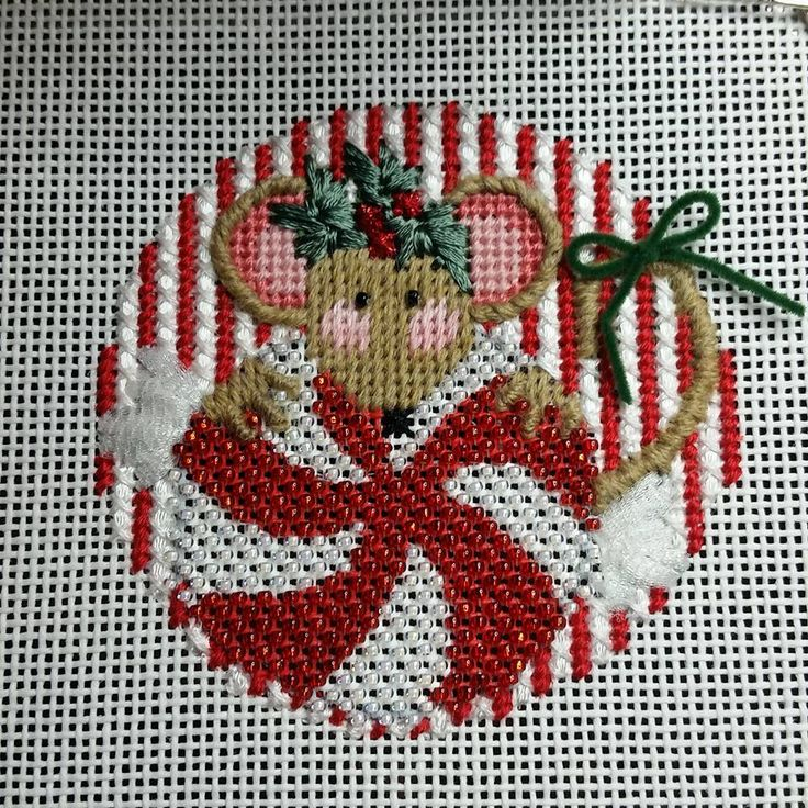 needlepoint Christmas mouse ornament eating peppermint candy