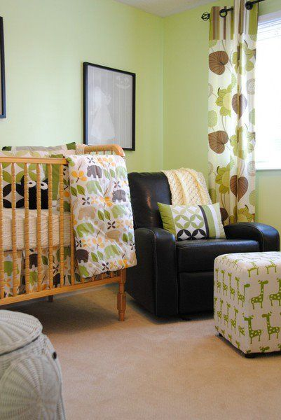 Sweet green baby room that feels lively but calm and relaxing in one.