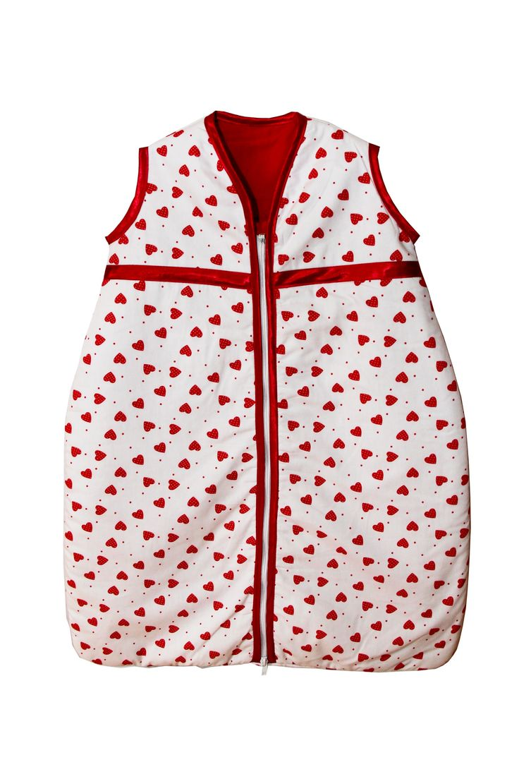 Very pretty red hearts design baby sleeping bag. Sizes 0-36 months. Satin trim to arms, neck and zip edge. Two layers of soft cotton with cosy inner batting. Central zip from bottom to top for ease of changing.