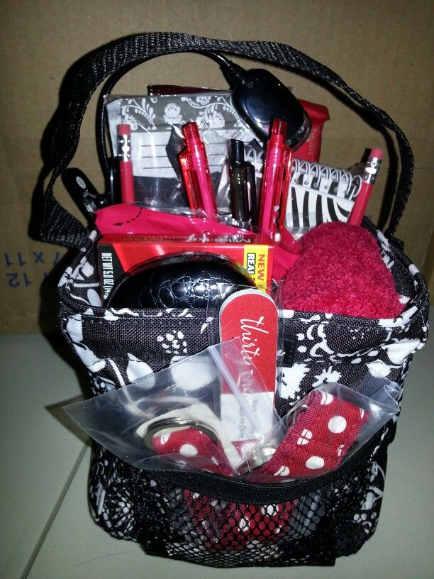 Game night gift basket, in a 31 Littles Carry All.  There are notepads, pens, pencils, snacks, candy, pinochle cards, poker cards, fuzzy socks, an eyeglass case, book light, and for good measure-a 31 nail file & key fob.