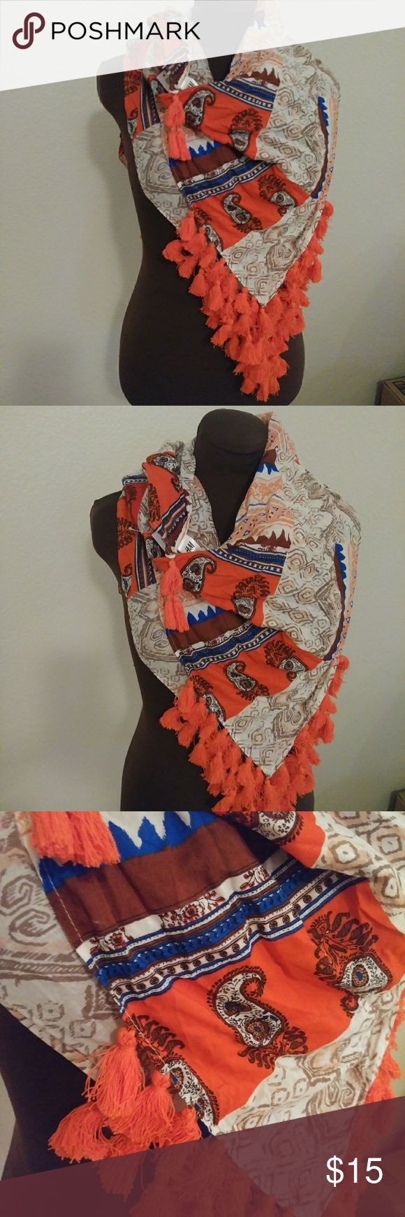 Tribal paisley tassle scarf New with tags! Square shaped scarf with tassle fringe on corner edges. Oranges, blues, cream and white colors. Can be woen so many ways. I have the scarf folded diagonally and lightly draped across the shoulders. H&M Accessories Scarves & Wraps