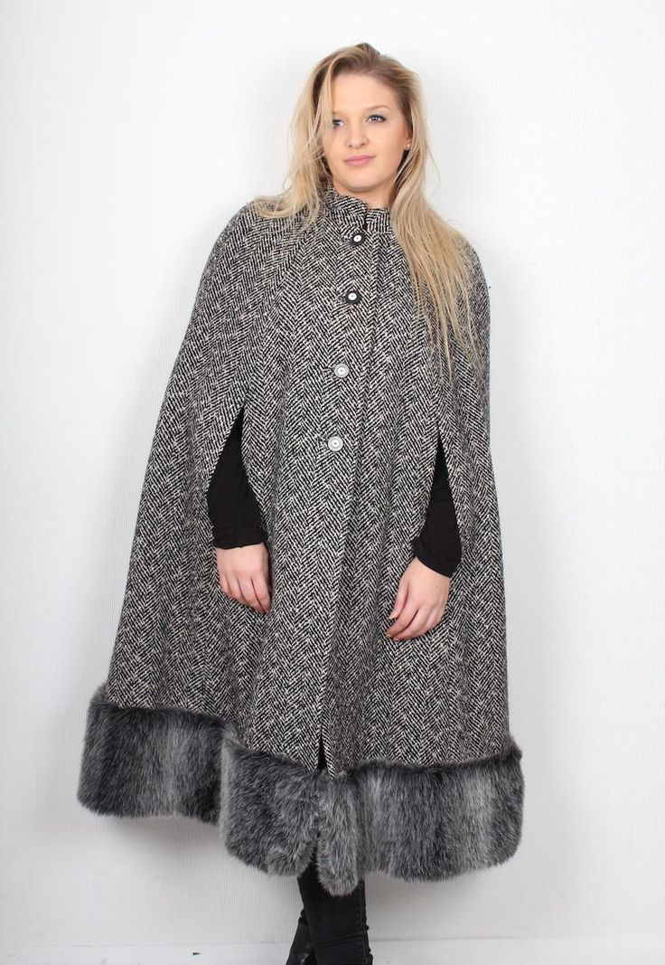 """Vintage tweed cape, featuring gorgeous tweed cloth, two slits in cloth for arms, gorgeous silver faux fur thick hem purple silky lining and monochrome buttons up centre front to fasten. Good condition overall. Super gorgeous for the winter months! Label reads - N/A size fits - one size shoulder to shoulder - 18"""" back of neck to hem - 43"""" model height - 5ft 6"""". Please compare measurements against your favourite fitting garment, to ensure accurate fit."""
