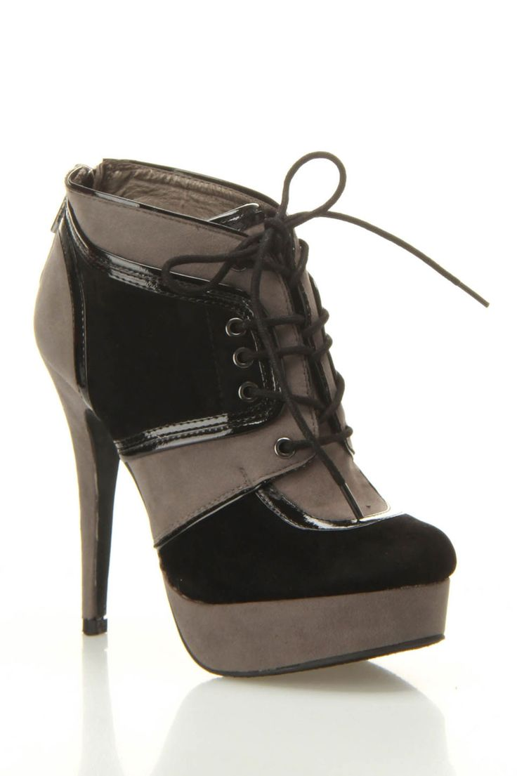 It's like the shoe is wearing a corset!! Dollhouse Fly Lace Up Bootie In Black - Beyond the Rack