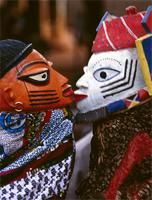 Awo masks performing at Yoruba Gelede masquerades, Benin. Two masks illustrate well-known cautionary Yoruba proverbs; the uncontrollable passion of romantic relationships.