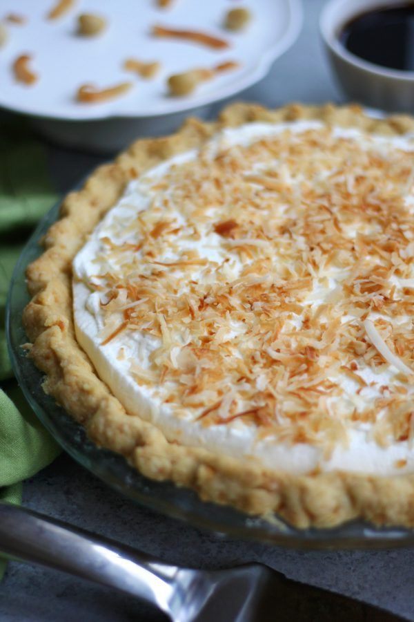 A cherished Hawaiian dessert,Haupia Pie with Macadamia Crust is as exciting to eat as attending your first luau. This gorgeous pie has a flaky and nutty crust, rich coconut chocolate layer, coconut cream layer all topped with fluffy whipped cream. You will be in heaven from the first bite.