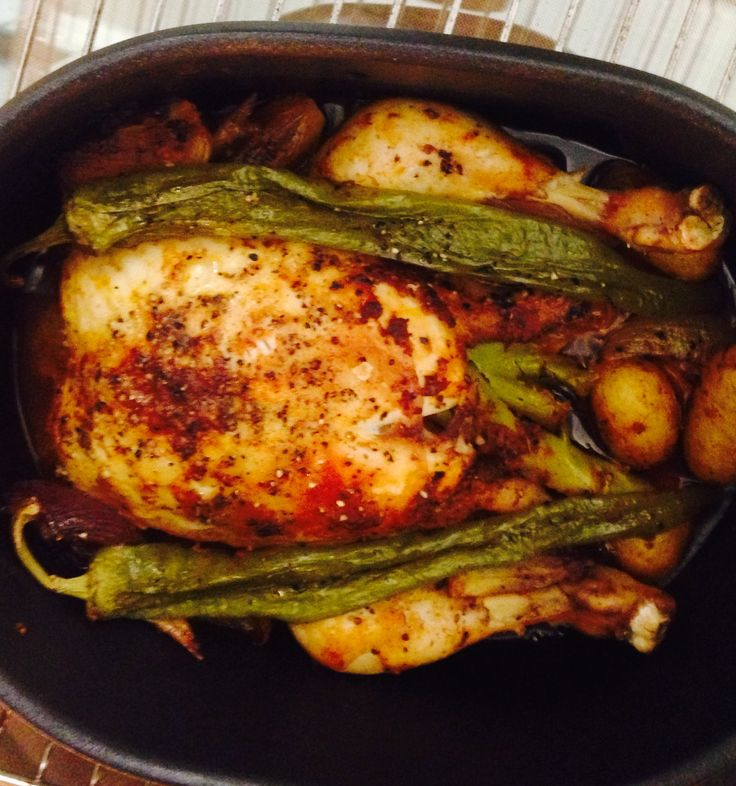 Roasted chicken with garlic, herbs , lemon , onion , spices, nutmeg,  cloves, cinnamon, black pepper, paprika, cardamom,  green bell pepper, Olive oil and potatoes