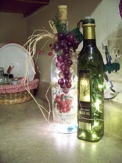 ~Wine Bottle Lamp~(no cutting/drilling required) Just insert string of xmas lights from top & embelish bottle with cascading grapes & leaves to cover the wire. Change decor for each holiday!