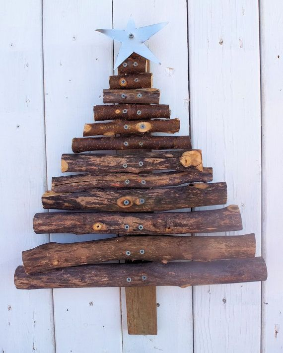 As important as a mug of hot chocolate by a roaring fire, your rustic Christmas decor wouldn't be complete without a primitive Cristmas tree handmade from reclaimed wood. Description from etsy.com. I searched for this on bing.com/images