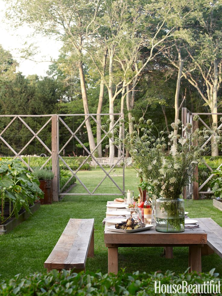 Rustic yet refined, a 10-foot-long table sits in the center of landscape designer Lisa Bynon's vegetable garden in Southampton New York. A graphic cedar deer fence encloses formal raised planting beds. Get inspired with 50 outdoor room ideas » - HouseBeautiful.com
