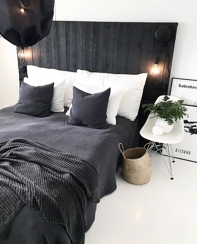 Love this monochrome bedroom. Love the use of the Eames chair as a side table!