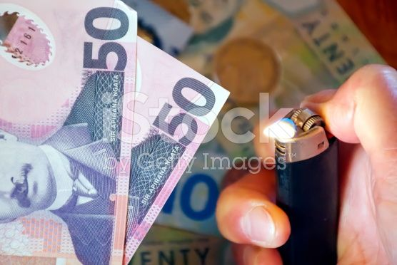 New Zealand Money (NZD) and Lighter royalty-free stock photo
