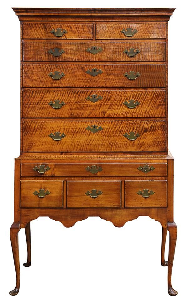 """American Queen Anne flat top highboy, executed in highly figured tiger maple, circa 1770, having a molded top, surmounting the graduated ten drawer case, above a shaped apron, and rising on cabriole legs terminating on pad feet, 70.5""""h x 38.5""""w x 21""""d."""