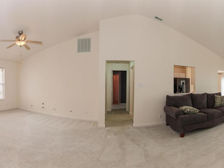 Great Room / Dining Area wide angle view.  New ceiling/fan/light, fresh paint, neutral carpet.