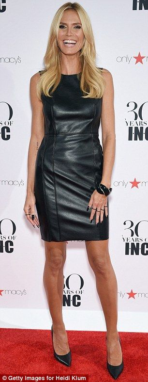 Stunning: The 42-year-old appeared ageless in a tight leather dress...