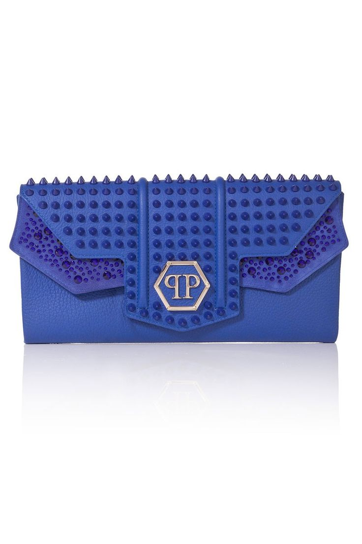 Super cool clutch embellished with shiny crystals as well as studs all over. The hexagonal logo makes it an iconic PP piece, perfect to update your night outfits. Browse the complete Philipp Plein collection online at Boudi Fashion