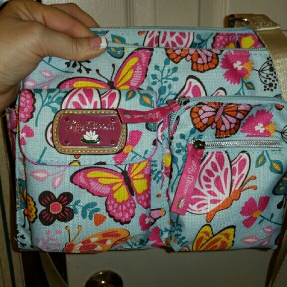 Lily Bloom Purse Never used....no tags...found to be to small for my needs.  Excellent condition....lots of pockets. lilly bloom Bags Crossbody Bags