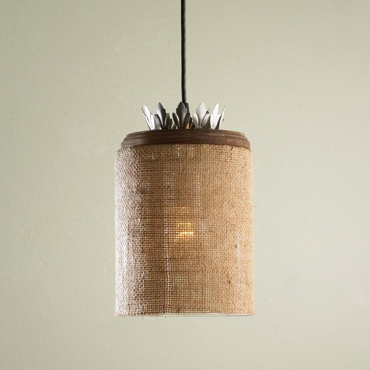 Burlap and Glass Pendant Light This eclectic pendant light takes burlap to a whole new level. Burlap wrapped glass is topped with an aged wood cap and steel crown bobeche. 60 watts