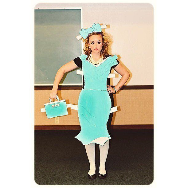Turn a favorite childhood plaything into your costume this year by cutting clothing shapes out of poster board, leaving a few square tabs along the sides. Simply tape the cutouts to your clothes and doll yourself up (pun intended) with girlie hair and makeup for a great costume!