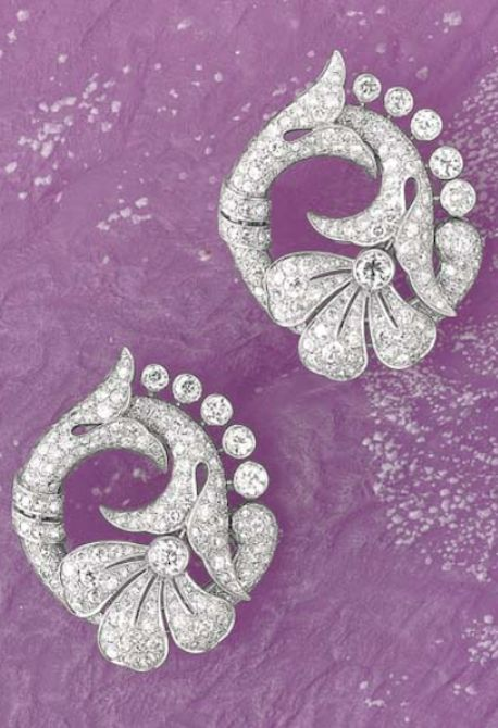 A Pair of Diamond and Platinum Double-Clips, circa 1930 Designed as a papyrus flower decorated with old-cut diamonds, mounted in platinum, 4.8 x 4 cm.
