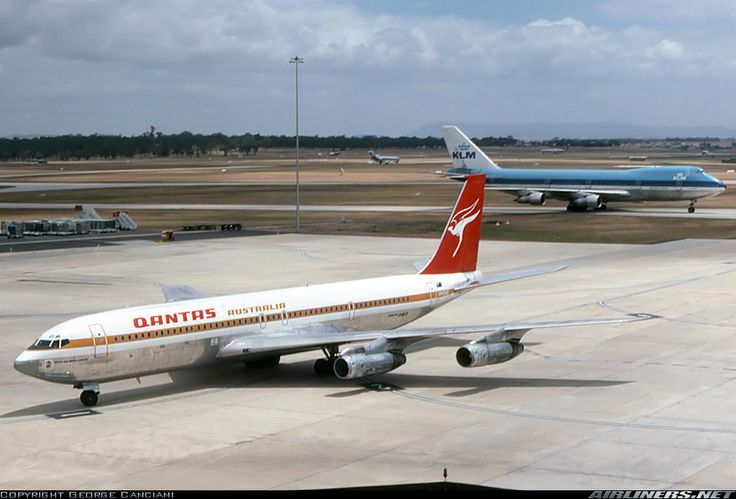"Qantas Boeing 707-338C VH-EAD ""City of Ballarat"" at Melbourne-Tullamarine, December 1977. A newly arrived KLM Boeing 747 is also taxiing towards the terminal. (Photo: George Canciani)"
