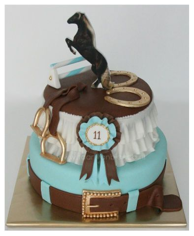 Equestrian style cake with rosette, horse shoes, stirrups, english / western belt