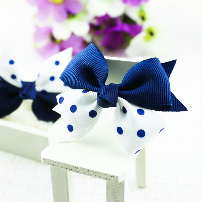 A pair of boutique bow hair ties in grosgrain ribbon with accent dots or bubble print and a bead on elastic band. Material: Cross Grain Ribbon, Satin Ribbon, Elastic Band Condition: New with Tag Item