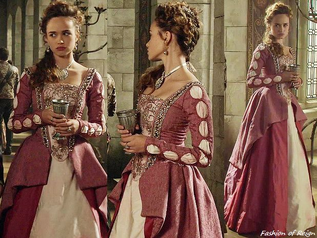 """In the episodes 3x09 (""""Wedlock"""", pictured above) and 3x16 (""""Clans"""") this Reign Costumes custom pink and ivory embellished dress. In the episodes 3x09 she wears it with these Mela Jewelry earrings, and this Rightful Owner tiara, Maria Elena Headpieces..."""