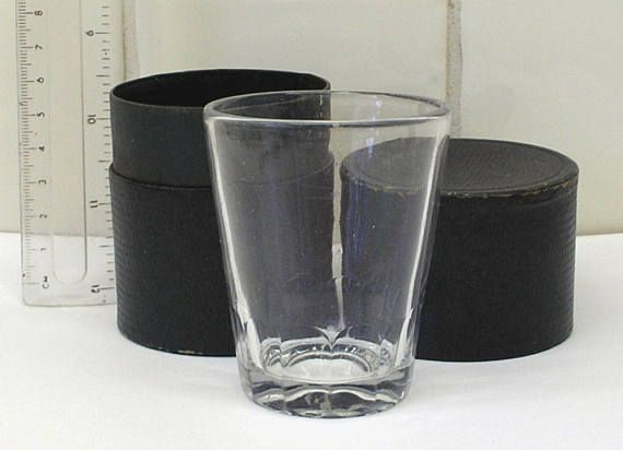 Antique shot glass in case. Travel beaker in faux dark green leather round box, stirrup glass cup. Edwardian Victorian film TV theatre prop
