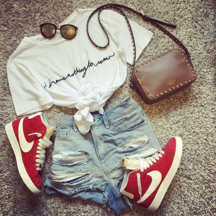 Perfect casual outfit for a summers day. Ripped denim shorts, red Nike high tops, Tan Valentino stud camera bag, le specs sunglasses and essential 'I have nothing to wear' slogan tee!