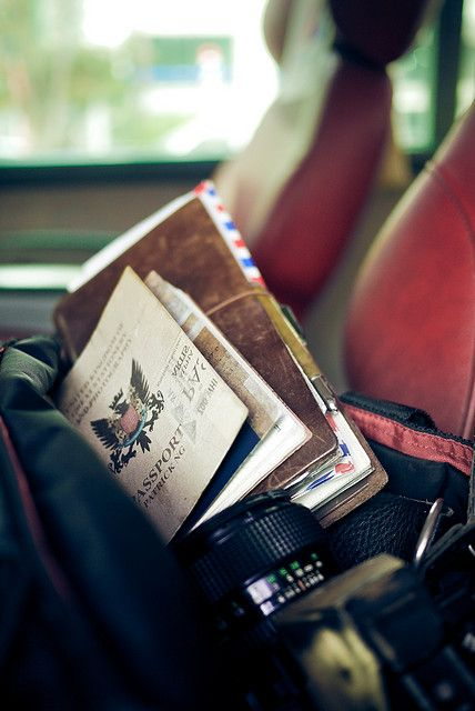 Traveler's Notebook and camera on big red airport bus couch - Seoul, Korea by Patrick Ng, via Flickr