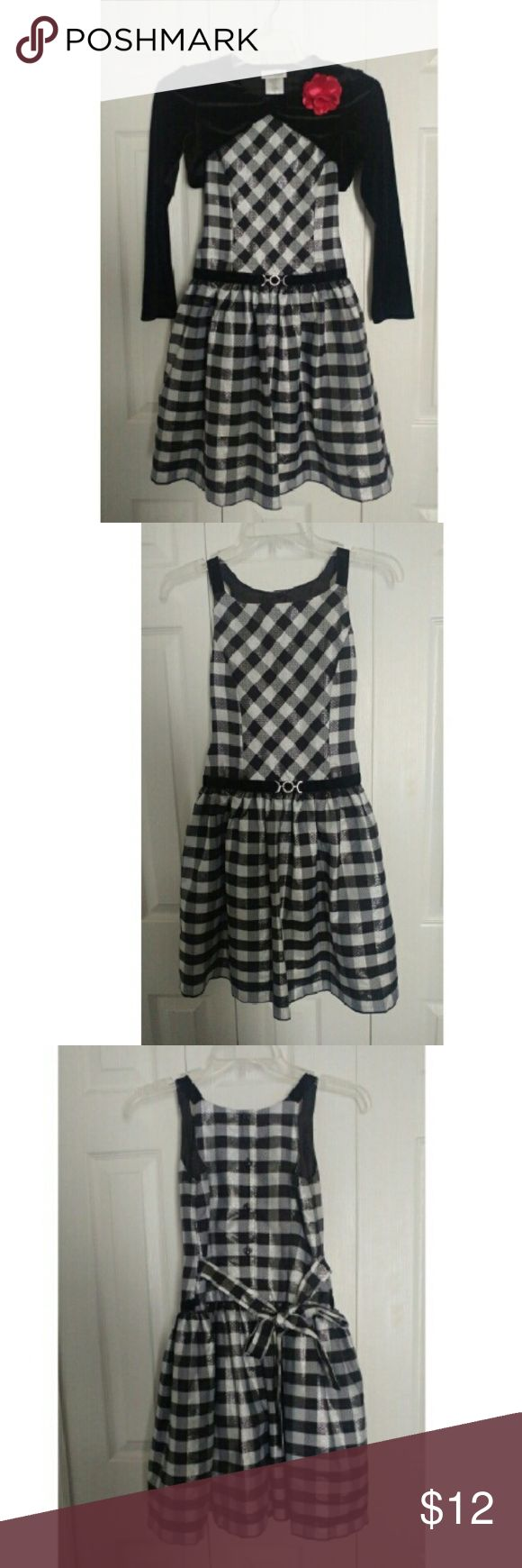 Black and white dress for kids Black and white dress for girls between 9 to 10 years old in great condition, only wore it once on christmas. Dresses Formal