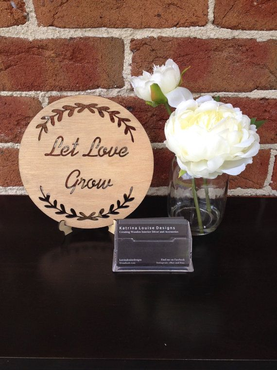 The cut out LET LOVE GROW timber plaque with wreath is created and designed by Katrina Louise Designs for Engagements, Weddings, gifts and decorations.