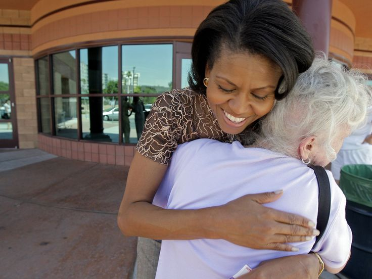 Michelle Obama,  wife of Democratic presidential candidate Barack Obama, huged Marilyn Schumacher outside the Cambridge Community Center in Las Vegas, Wednesday, June 13, 2007. It was Michelle Obama's first stop in Nevada on behalf of her husband since the Illinois senator launched his presidential campaign.