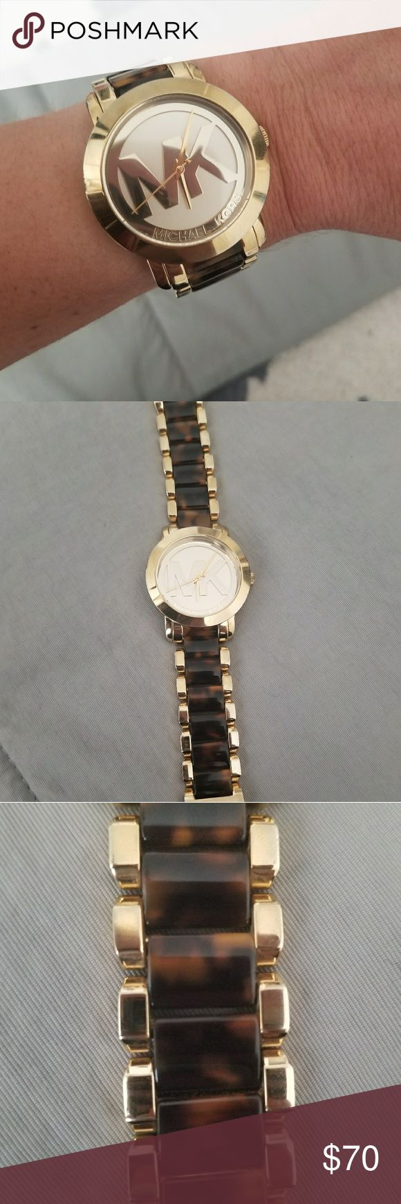 Michael Kors Watch 💗 My absolute favorite watch 💗   Classy gold face and trim with dual brown links. Great condition, only worn a few times.   Needs new battery but I can replace if easier for you. Just add $5 to price.  Small scratch top left edge of face, scuff shown in last picture. Hardly noticeable. Picture represents true condition. You'll absolutely love this watch.   Priced lower only because of battery and small scratch. Message me if you have any questions!  Ships in 2 days, can…