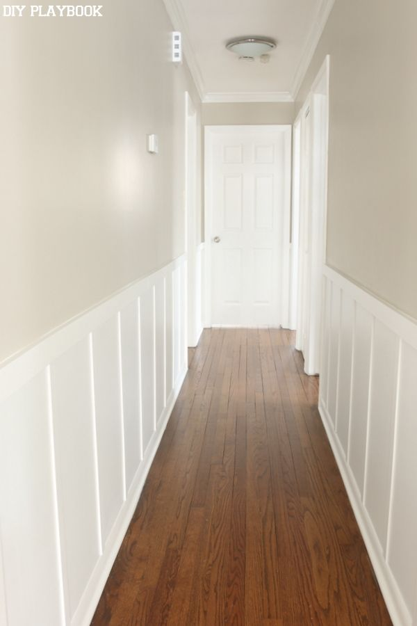 White hallway board and batten for less than $100. Such an easy DIY project that adds so much to any boring wall.