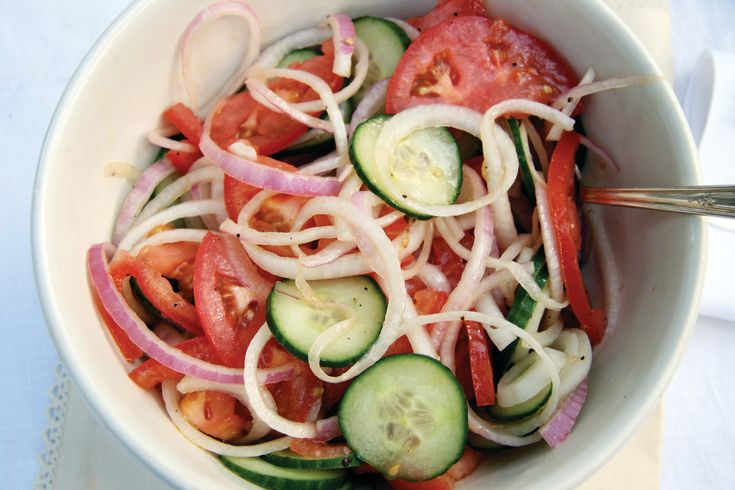 A simple, delicious fresh market salad that is so easy to make, with a drizzle of oil and vinegar.