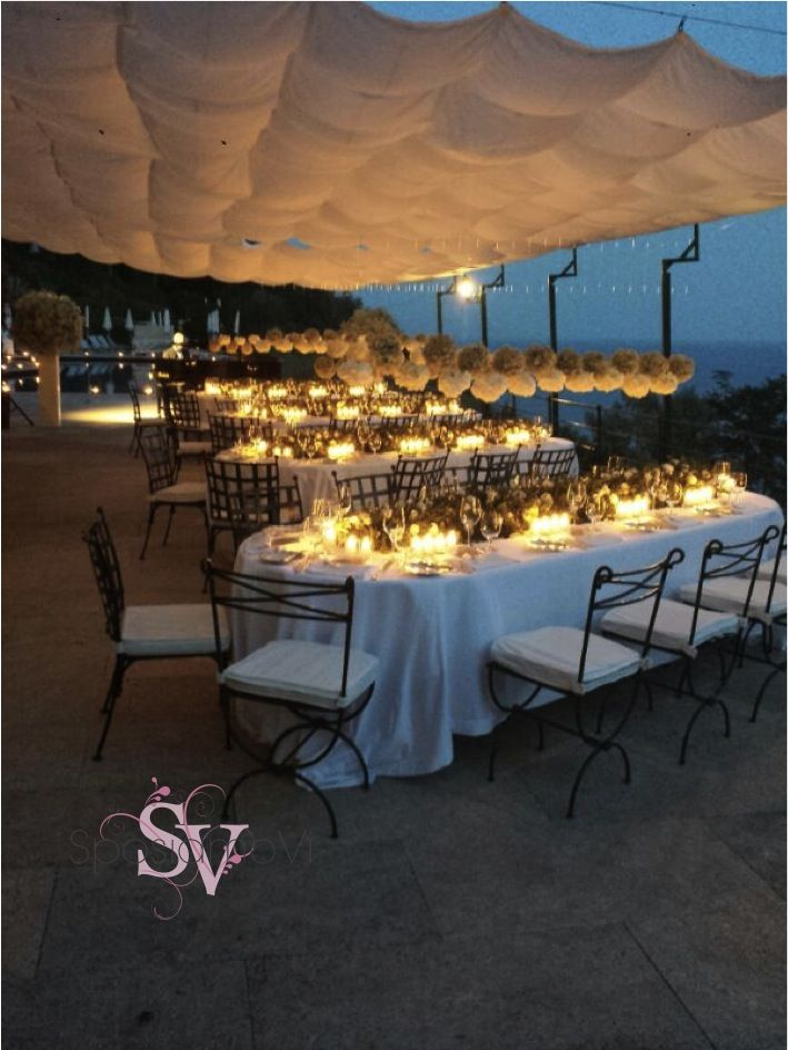 Hanging floral decorations and candle light - Portofino wedding reception by SposiamoVi.it