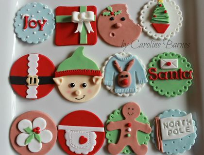 Variety of Christmas cupcake toppers - present, santa suit, gingerbread man, elf, rudolph jumper, letters to Santa, Christmas pudding, Mrs Claus apron.