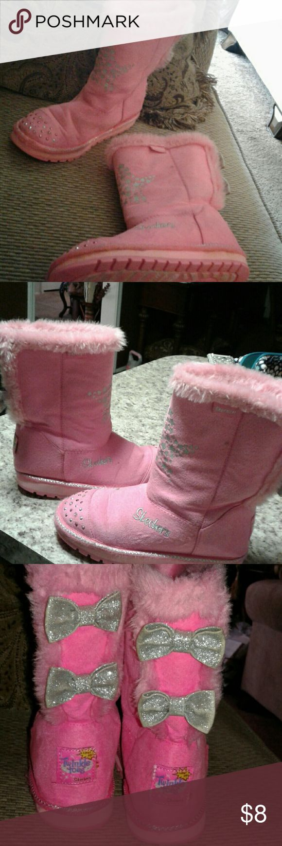 Skechers Pink Light Up Boots Pink light up boots by skechers. Pretty Silver bows on back. Left boot light up does not work. Still great boot for kids. (Bundle with other items in my closet and pay only $6.49 shipping ) Skechers Shoes Boots