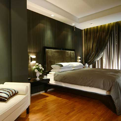 Contemporary Bedroom With Wood Floor Gray Bed Cover And Dark Green Walls And Khaki Drapery