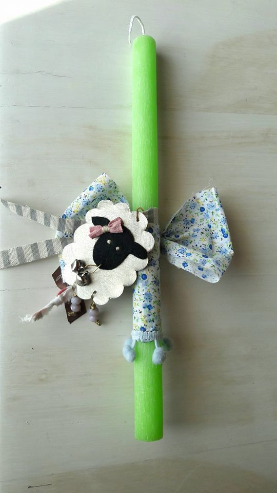 Miss Lamb. By metal leaf and fabric and an aromatic candle.