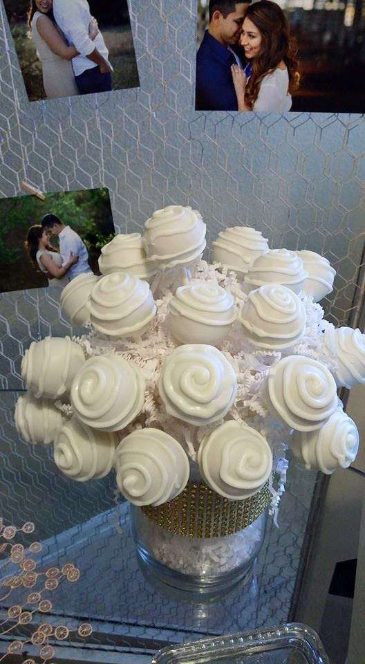 Cake pop bouquet at a white and gold bridal shower  party! See more party planning ideas at CatchMyParty.com!