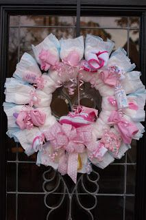 The Door: I made a diaper wreath for the door. Super easy, white styrofoam wreath, curly ribbon, diapers, stuff. Again, easy and inexpensive.