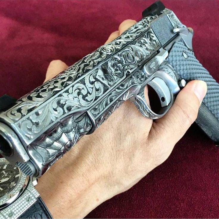 """Check out @danbilzerian custom engraved 1911"""