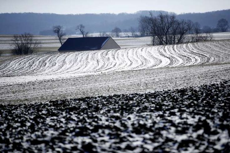 Winter Weather - RONKS, PA -  The sun reflects off of snow and ice on a farmer's frozen field in Ronks, Pa., Tuesday, Jan. 2, 2018.